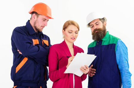 Builders and engineer work together. Female supervisor concept.