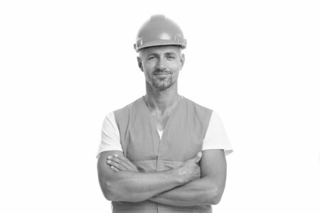 architect isolated on white. engineer man in hard hat. industrial man engineer with crossed hands. working at construction building. repairman wears hardhat. road repair concept. Building Фото со стока
