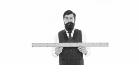 bearded man with ruler isolated on white. Measuring his height with ruler. university teacher hold ruler. size and length measurement. school stem disciplines. back to school. Measuring his beard