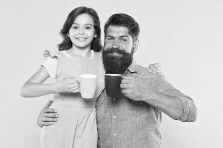 Tea for two. Happy family enjoy drinking tea together. Small daughter and father hold tea cups. Morning drink. Breakfast time. Happiness is cup of tea