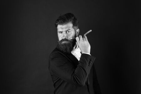 Barbershop for gentlemen only. Businessman hold barbers tool dark background. Bearded man shave in barbershop. Barbershop concept. Shave and haircut. Barber shop. Barbershop style starts here Фото со стока