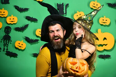 Girl and bearded man with smiling faces on green background