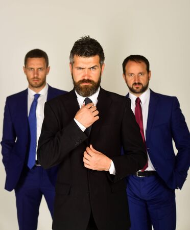 Men with beard and strict faces stand for partnership