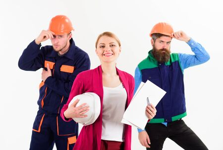 Woman with hard hat and smiling face manages mens team