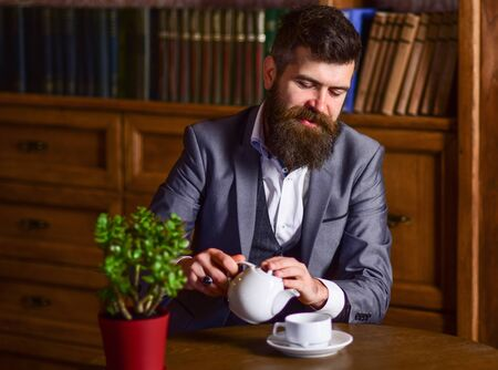 bearded man participates in the tea ceremony