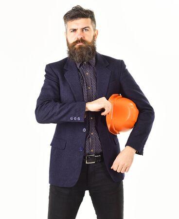 Architect wears construction helmet. Architect with long beard and serious face Reklamní fotografie