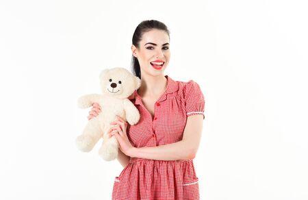 Beautiful girl in studio is holding a teddy bear Zdjęcie Seryjne