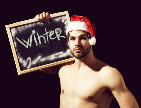 santa muscular man with winter blackboard