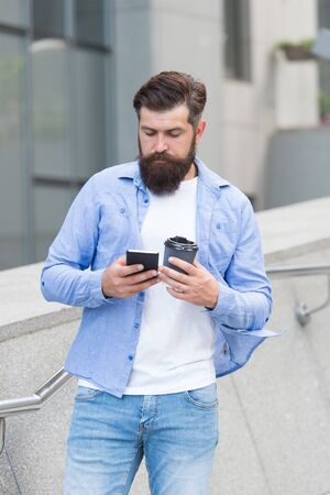 Internet surfing social networks with smartphone. Energy. Coffee time. Mobile phone always with me. Man use smartphone. Waiting for message. Modern life. Man with smartphone drinking coffee