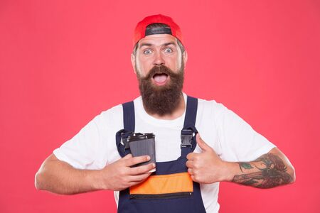 Energy concept. Caffeine addiction. Brief coffee break provides employees with quick ways to relax. Coffee breaks keeps you awake and alert. Mechanic enjoy coffee. Handsome builder hold coffee cup