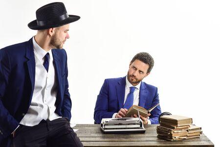 Businessman wears oldfashionate mafia hat. Men in suits Фото со стока