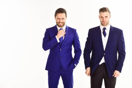Businessmen in suits on white background. Man with beard Фото со стока