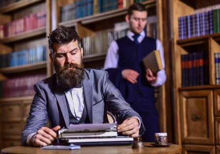 Men in suits, professors, aristocrats in library or retro interior