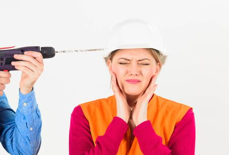 Incompetent female worker with drill on white background.