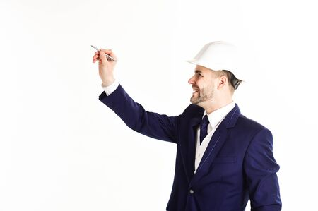 Businessman or engineer holds pen on white background. Фото со стока