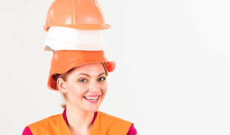 Architect, engineer, builder with protective hard hats on head.