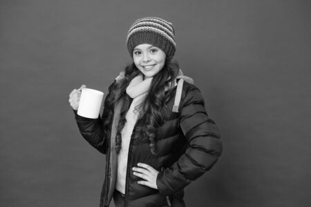 Protein cocktail. Happy child enjoy drinking tea or coffee. Little girl hold drinking mug. Healthy drinking habits. Drinking cocoa or chocolate. Hot drink. Winter holidays. Morning breakfast concept