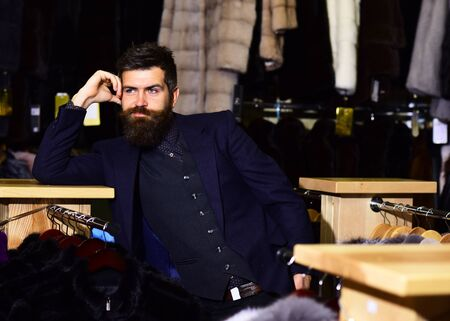 Man with beard and mustache in fur shop.