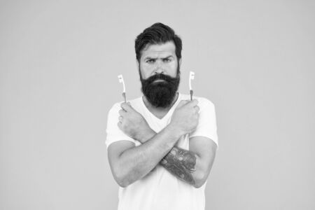 No toothache. Bearded man hold toothbrushes. Hipster with tooth brushes. Teeth care. Oral hygiene. Dental care. Fresh breath. Protecting teeth. Take care of your teeth