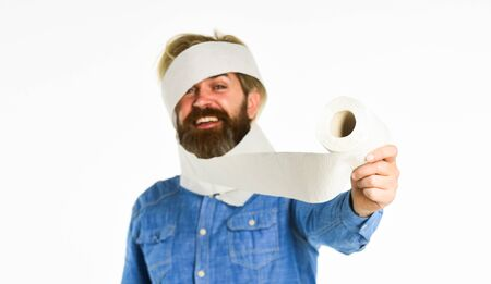 Hipster Guy having fun. Softness strength and absorbency. Prevent Toilet Paper Hoarding. Shortage of goods. Coronavirus toilet paper shortage. Essential goods. Consumerism. Man hold toilet paper Stock Photo
