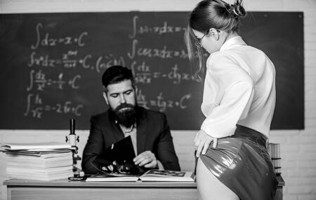 Seductive offer. Check knowledge. Desire for knowledge. Sex knowledge. Need for real experience. Teacher and student. butt red latex skirt in front of teacher. Private lesson