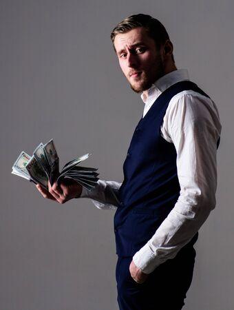 Rich man, successful entrepreneur get cash, banknotes, currency, dollars.