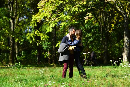 Couple in love walks in park. Girl and bearded guy