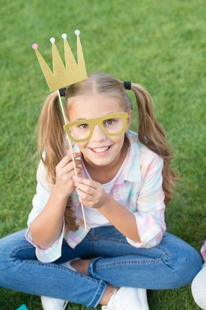 Because your worth it. Happy girl wear prop crown and glasses. Big boss. Beauty queen crown. Party crown. Coronate symbol. Carnival fashion accessories. Beautiful from toe to crown