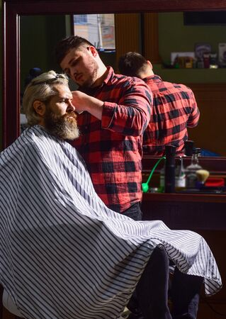 Sharp object near face and squirming distracts person holding it. Donate hair. Donation and charity concept. Guy with dyed blond hair. Cut hair. Barber hairstyle barbershop. Hipster getting haircut. Banco de Imagens
