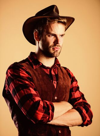 wanted. western cowboy portrait. man checkered shirt on ranch. Vintage style man.