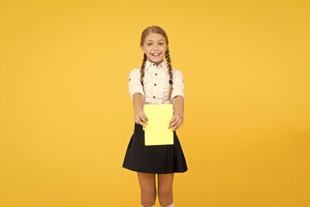 Schoolgirl wear school uniform. Knowledge day. Girl with copy book or workbook. Kid student ready with homework. School girl excellent pupil prepared essay or school project. Raising independence