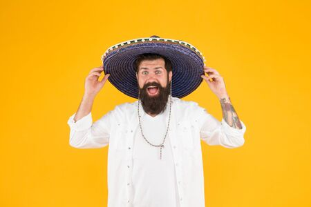 Time to relax. vacation concept at resort in mexico. hipster with beard looks festive in sombrero. happy brutal male celebrating fiesta. guy in poncho. sombrero party man. man in mexican sombrero hat Stock Photo