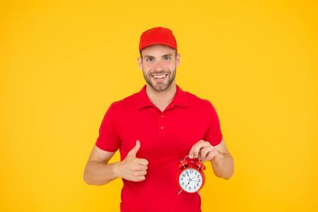 Timeliness guarantee. Promptness and punctuality. Delivery time. Delivery courier with clock. Delivery man holding clock. Shipping services. Post office. Online shopping. Will deliver at agreed time