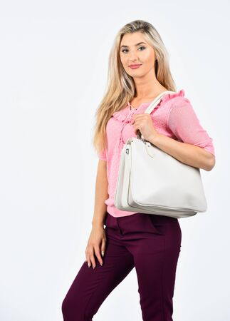 Looking trendy. girl carry big leather bag. beauty and fashion accessory. beauty of woman isolated on white. casual and everyday style. female fashion style. pretty woman with long blond hair