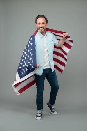 Immigration to USA. Mature man hold US flag. Visa for immigration travel. American green card. United States permanent residency. Citizenship and immigration. Immigration and naturalization service