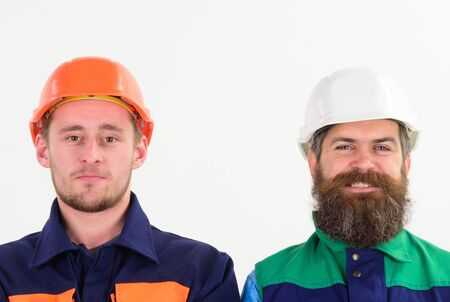 Friends at work concept. Men in hard hats and uniform