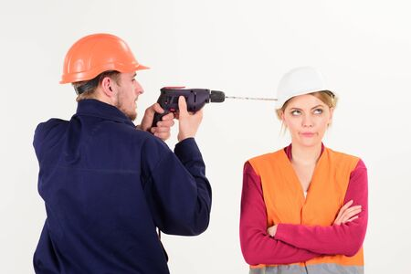 Woman with bored face in helmet ignoring husband annoying her. Archivio Fotografico