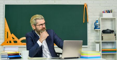 Lost in thoughts. Serious man back to school. Senior teacher look serious in glasses. Business coach thinking with serious face. Profound thinker. School and education. Serious and thoughtful