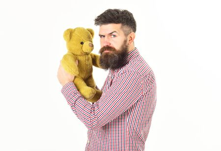 Guy with beard does not like to share soft toy.