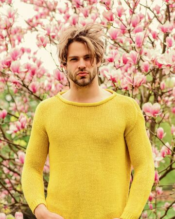 Joy of spring. Man flowers background. Spring beauty. Modern hipster enjoy blossom. Springtime concept. Guy relax in flowers park. Botanical garden. Freshness and awakening. Spring inspiration Standard-Bild