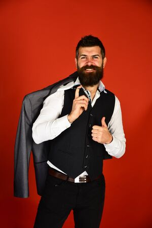Man with beard holding jacket. Businessman with happy face