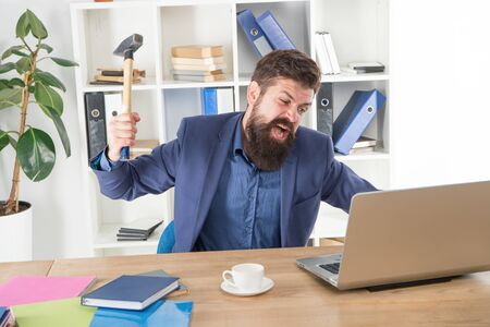 Destroy laptop. Hateful job. Bad computer. Mad manager. Annoyed user. Slow internet connection. Outdated software. Computer lag. Lagging system. Hate office routine. Man bearded crush computer