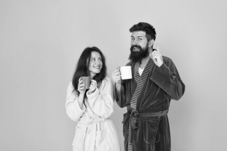 Morning inspiration. happy family day. man and woman drink cup of tea. Spending great time at home. couple in love enjoy morning. wear cosy robe. Tastes delicious. Breakfast time. relax with coffee Foto de archivo