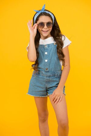 cheerful child has vintage look. headkerchief and sunglasses - summer accessory. beauty and fashion. happy childhood. retro girl feel happiness. small kid wear summer outfit