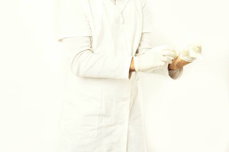 Male hands of doctor wearing medical gloves