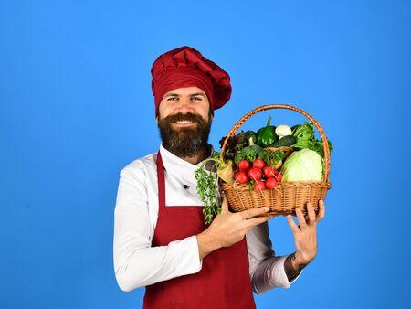 Chef holds cabbage, radish, broccoli with lettuce, pepper and garlic 版權商用圖片