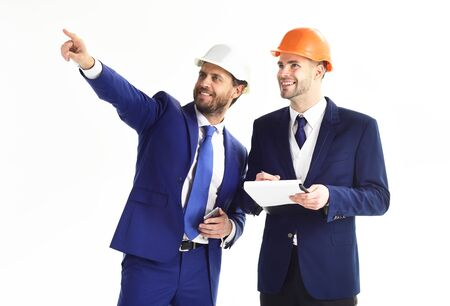 Happy boss pointing something to employee. Success, work, building concept.