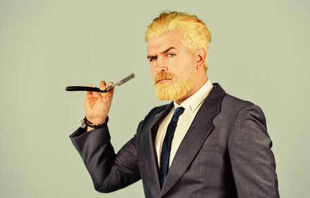 Facial care. grooming for formal meeting. male beauty and personal hygiene. professional barber cut and shave. barbershop. confident businessman hold hairdresser tools. mature man dyed beard and hair