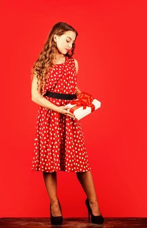 Confident in her choice. happy valentines day. birthday gift box. boxing day. christmas shopping sales. really nice purchase. surprise for pinup kid. retro party style. retro girl present box Reklamní fotografie