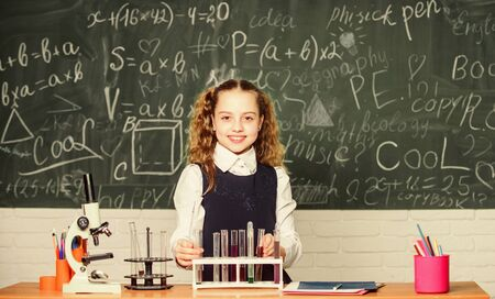 student doing biology experiments with microscope. Little child at school lesson. Chemistry. Back to school. childrens day. Little girl learning chemistry in school lab. She need an expert advice